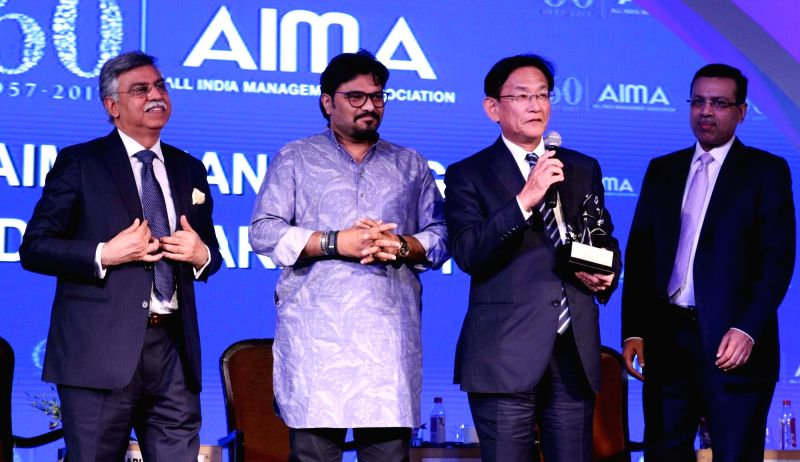 Maruti Suzuki's CEO and managing director Kenichi Ayukawa receives MNC in India of the Year Award, bestowed on Maruti Suzuki, from Union Minister Babul Supriyo at the AIMA Awards ceremony ... - Kenichi Ayukawa