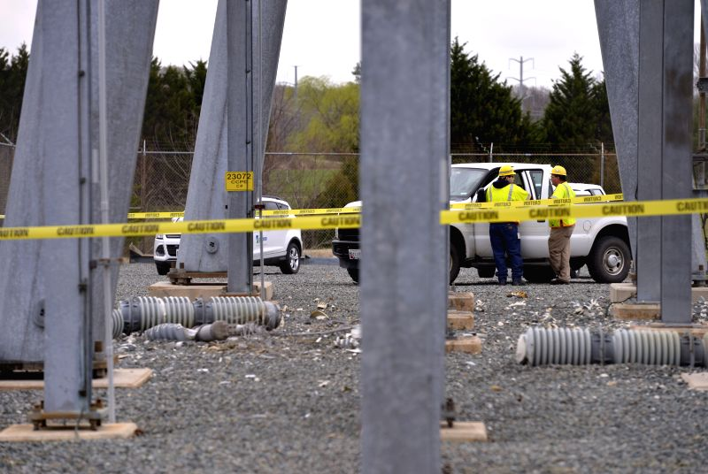 Workers try to repair the electrical fault at a switching station in Charles county of Maryland, the United States, April 7, 2015. Widespread power outage caused ...