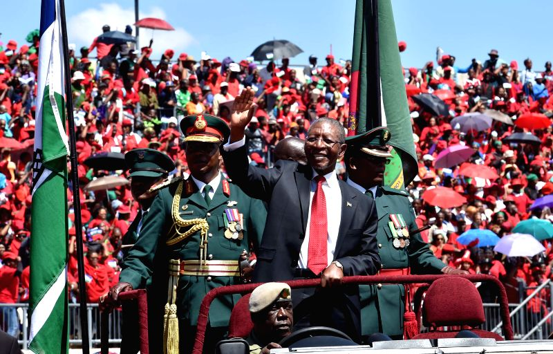 Lesotho's newly-elected Prime Minister Pakalitha Mosisili (front) waves to the spectators during the inauguration ceremony in Maseru, capital of Lesotho, on March ... - Pakalitha Mosisili