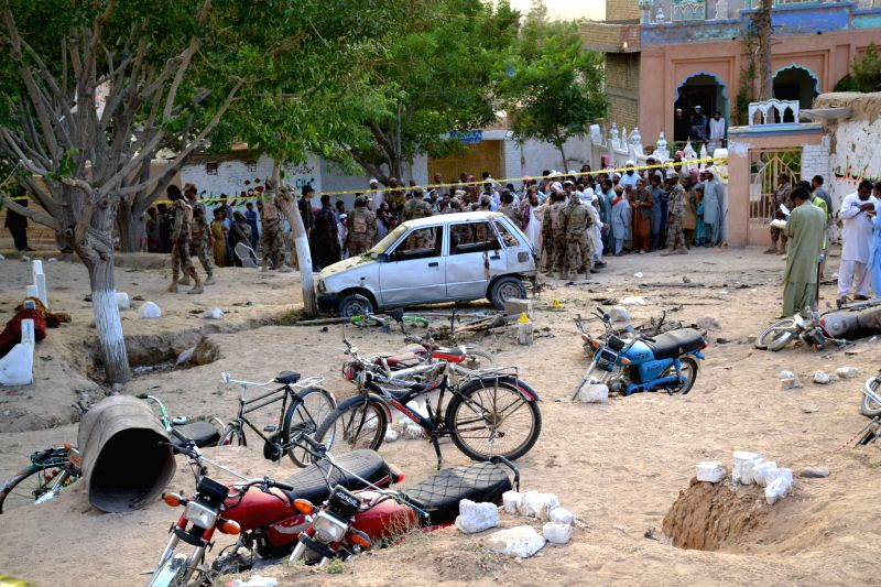 MASTUNG, May 12, 2017 - Locals gather at the blast site in southwest Pakistan's Mastung, on May 12, 2017. Pakistani Prime Minister Nawaz Sharif on Friday condemned the deadly attack targeted on the ... - Nawaz Sharif