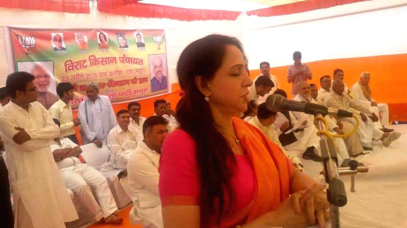 BJP MP Hema Malini addresses a farmers` panchayat near Mathura on April 23, 2015.
