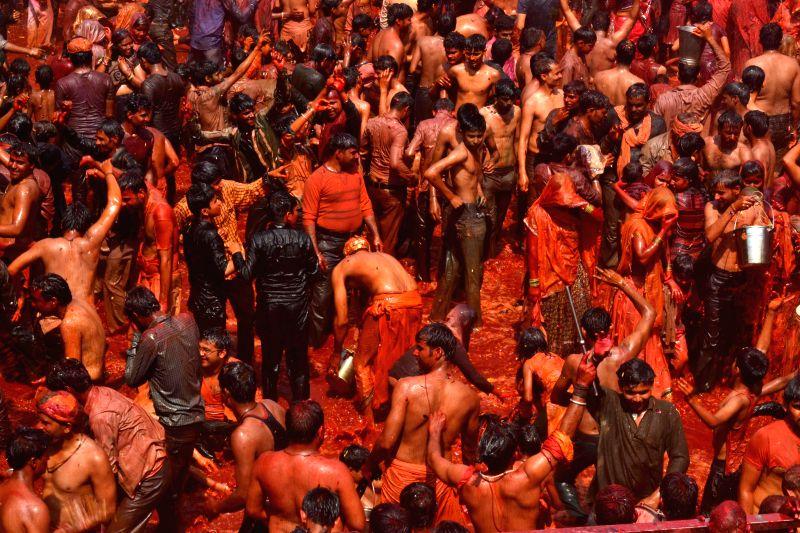 People celebrate Holi at Dauji Temple near Mathura, on March 7, 2015.