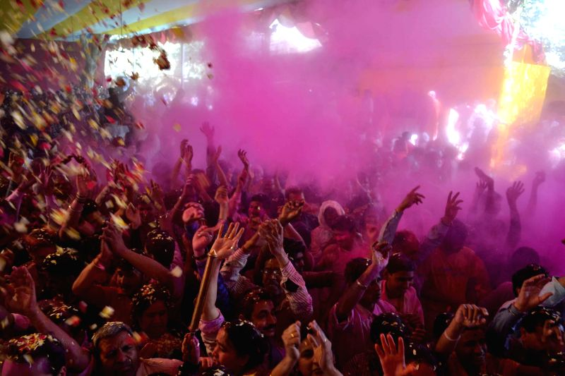 People celebrate Holi - festival of colours in Gokul, Mathura on Feb 22, 2015.