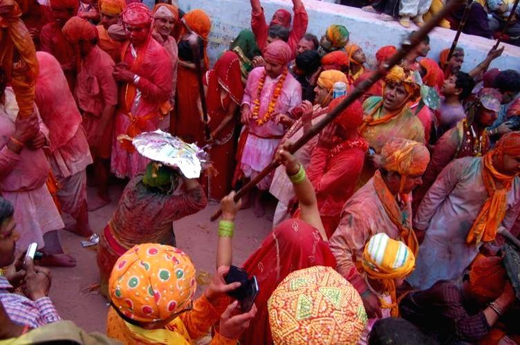 People participate in `Lathmaar Holi` in  Barsana of Uttar Pradesh's Mathura district, on Feb 27, 2015.