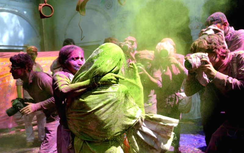 Widows celebrate Holi in Vrindavan of Uttar Pradesh's Mathura district  on March 3, 2015.