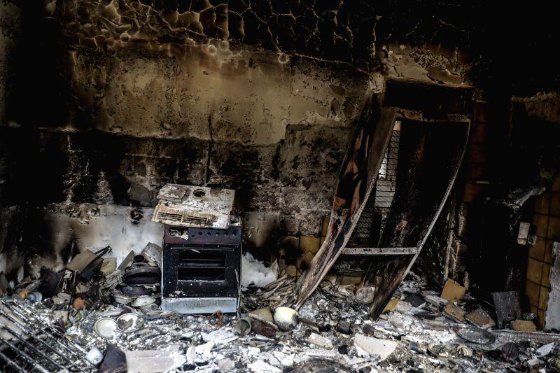 MATI (GREECE), July 24, 2018 A burned house is seen in Mati, a seaside town east of Athens, Greece, on July 24, 2018. The number of killed in the devastating fires near Athens was revised ...