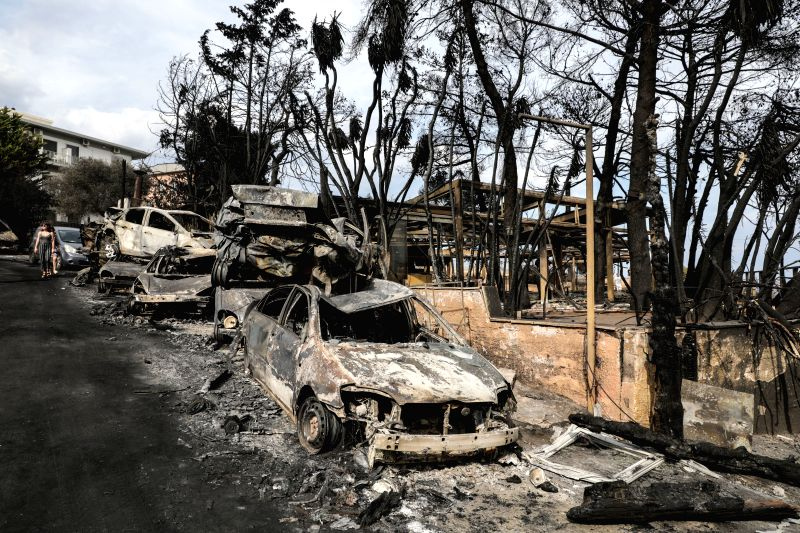 MATI (GREECE), July 24, 2018 Burned vehicles are seen in Mati, a seaside town east of Athens, Greece, on July 24, 2018. The number of killed in the devastating fires near Athens was ...