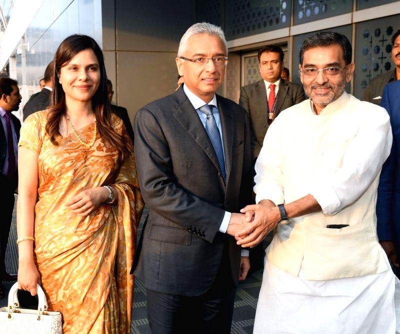 Mauritian Prime Minister Pravind Kumar Jugnauth and Kobita Ramdanee-Jugnauth being received by the Union MoS HRD Upendra Kushwaha, on their arrival at IGI Airport, in New Delhi on May 26, ... - Pravind Kumar Jugnauth