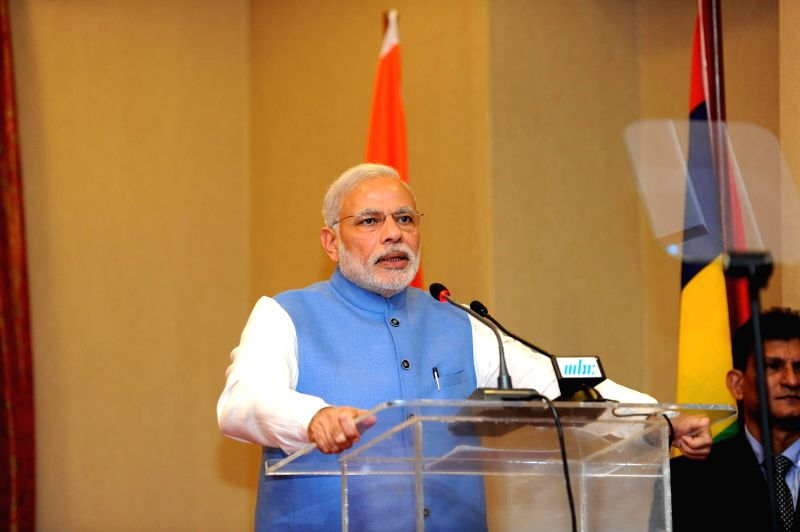 Prime Minister Narendra Modi addresses press after the delegation level talks with the Prime Minister of Mauritius, Sir Anerood Jugnauth in Mauritius on March 11, 2015. - Narendra Modi