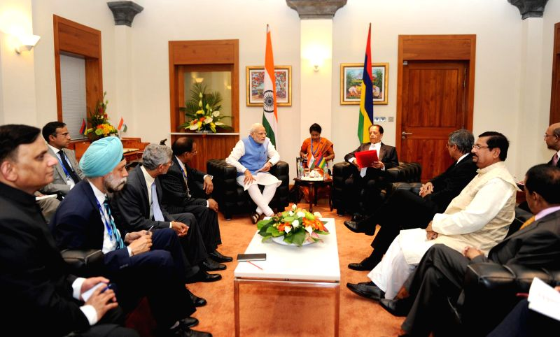 Prime Minister Narendra Modi and the Prime Minister of Mauritius, Sir Anerood Jugnauth during the delegation level talks, in Mauritius on March 11, 2015. - Narendra Modi