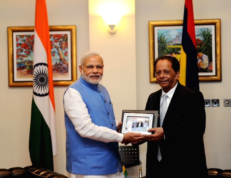 Prime Minister Narendra Modi and the Prime Minister of Mauritius, Sir Anerood Jugnauth during a meeting, in Mauritius on March 11, 2015. - Narendra Modi