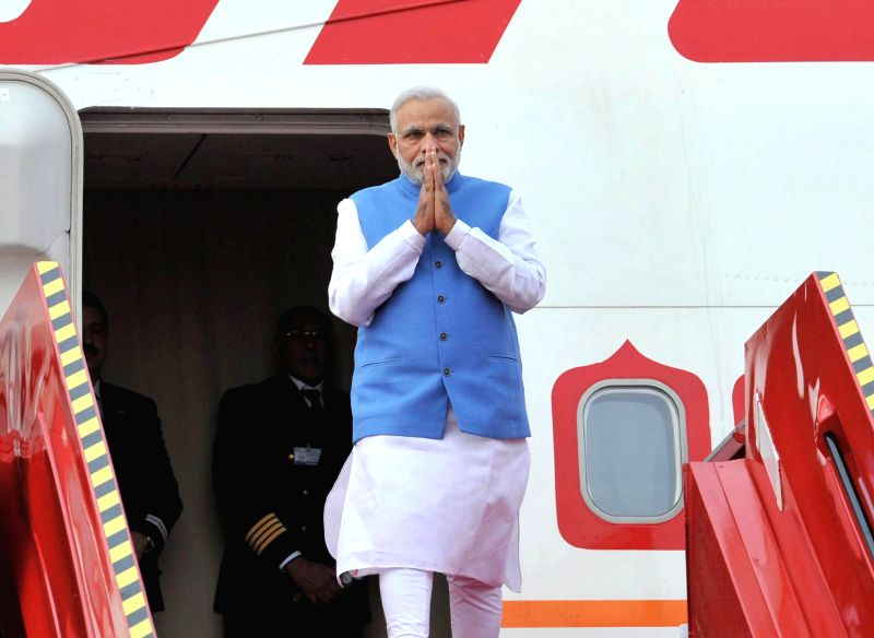 Prime Minister Narendra Modi arrives at Sir Seewoosagar Ramgoolam Airport, in Mauritius, on March 11, 2015. - Narendra Modi