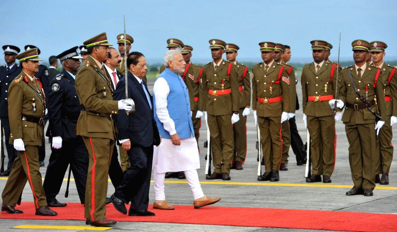 Prime Minister Narendra Modi inspects Guard of Honour at Sir Seewoosagar Ramgoolam Airport, in Mauritius on March 11, 2015. - Narendra Modi