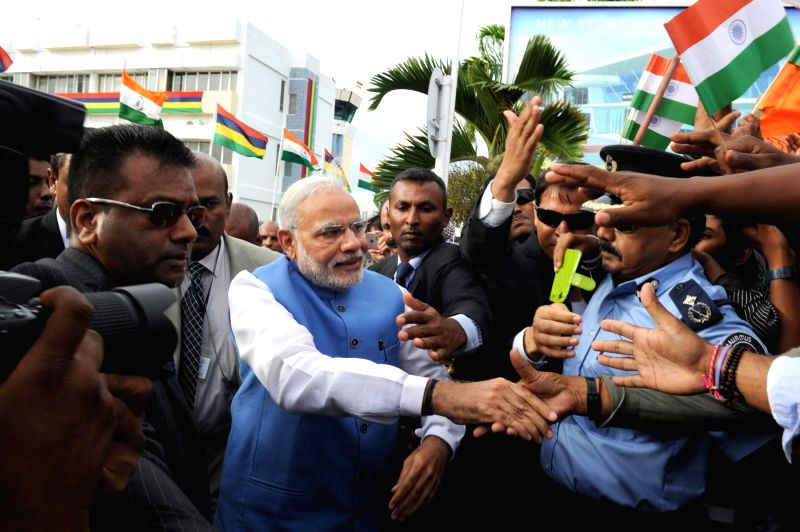 Prime Minister Narendra Modi meets the people outside the airport on his arrival, in Mauritius, on March 11, 2015. - Narendra Modi