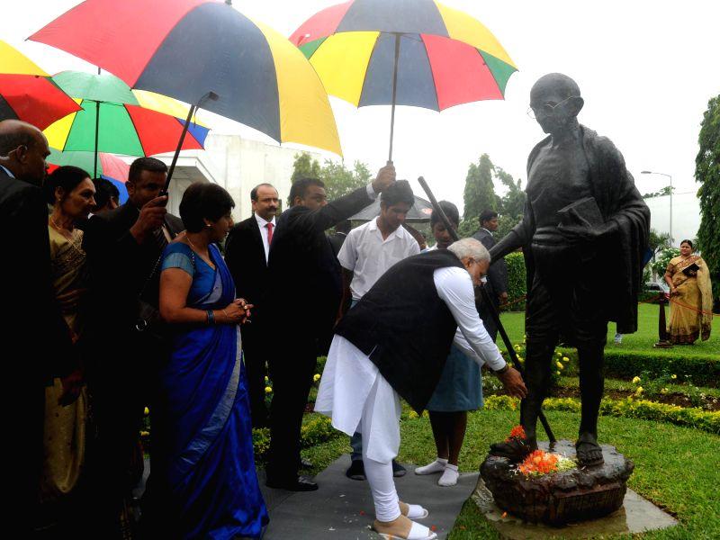 Prime Minister Narendra Modi pays homage at the Gandhi Statue at Mahatama Gandhi Institute of Mauritius on March 12, 2015. - Narendra Modi