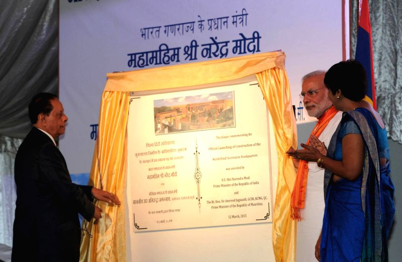Prime Minister Narendra Modi unveils the plaque to officially launch the Construction of the World Hindi Secretariat Headquarters, at Phoenix, in Mauritius on March 12 2015. Also seen the ... - Narendra Modi