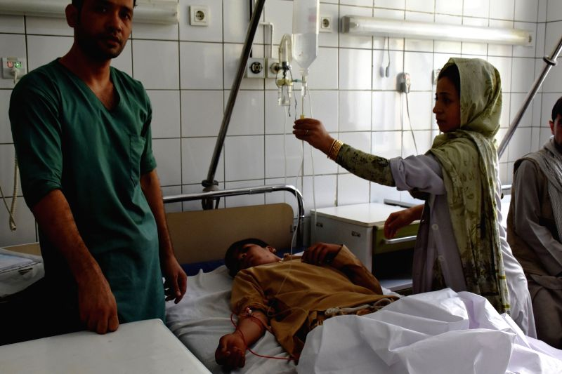 MAZAR-E-An injured man receives medical treatment after a suicide attack at a local hospital in Mazar-e-Sharif, capital of northern Balkh province, Afghanistan, Aug. ...