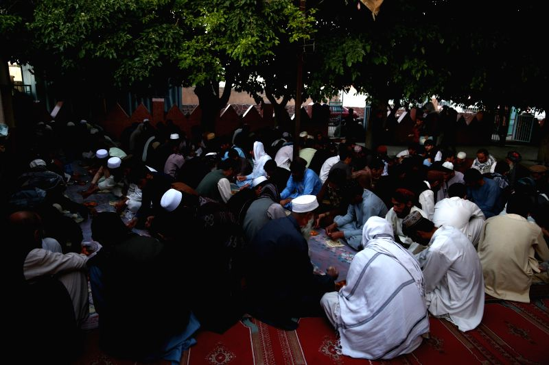 MAZAR-E-SHARIF, June 11 Afghan men pray after breaking their fast during the holy month of Ramadan in Mazar-e-Sharif, capital of northern Balkh province, Afghanistan, June 10, 2017.