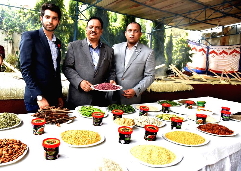 MD M. A. Majeed (centre) showing Haleem ingredients.