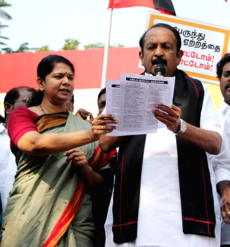 MDMK leader Vaiko, DMK leader Kanimozhi and other opposition party leaders stage a protest against the hike in bus fares; in Chennai on Jan 27, 2018.