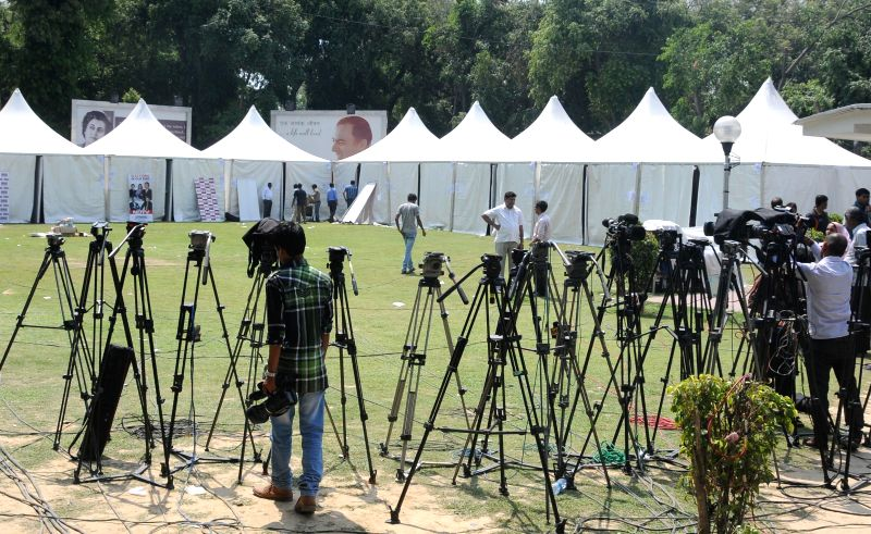 Media persons wait for congress leaders after party's poor performance in 2014 Lok Sabha Elections in New Delhi on May 16, 2014.