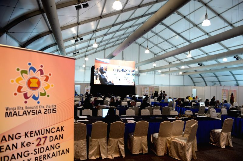 Media staff work at the media center of the 27th Association of Southeast Asian Nations (ASEAN) Summit in Kuala Lumpur, Malaysia, on Nov. 19, 2015. (Xinhua/Ma ...