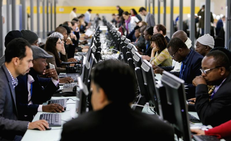 Media staff work during  the 2015 United Nations Climate Change Conference (COP 21) at Le Bourget on the northern suburbs of Paris, France, Dec. 2, 2015. The Paris ...