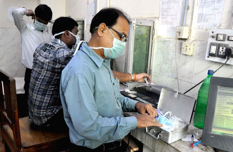 Medical staff wear masks as a precautionary measure against swine flu at B.C Roy Hospital in Kolkata, on Feb 25, 2015. - C Roy Hospital