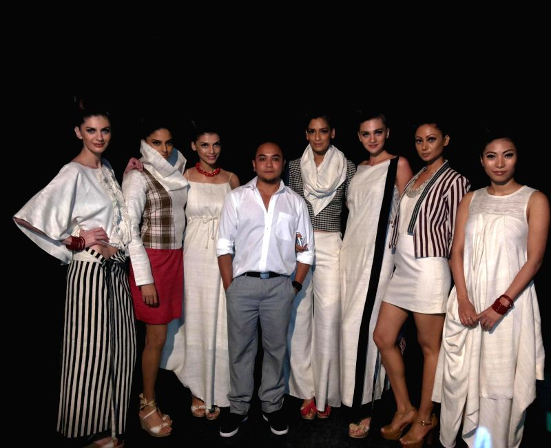 Meghalaya based designer Daniel Syiem with models during North East Fashion Fest in New Delhi.
