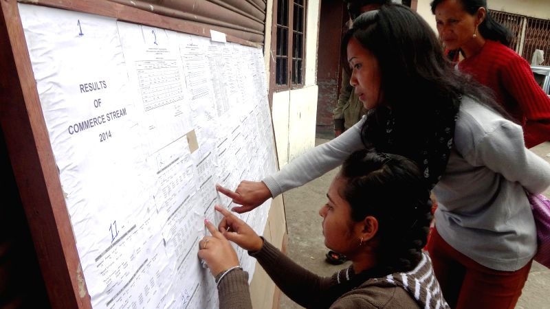 Meghalaya Board of School Education (MBOSE) students check out their higher secondary results at their school in Shillong on May 6, 2014.