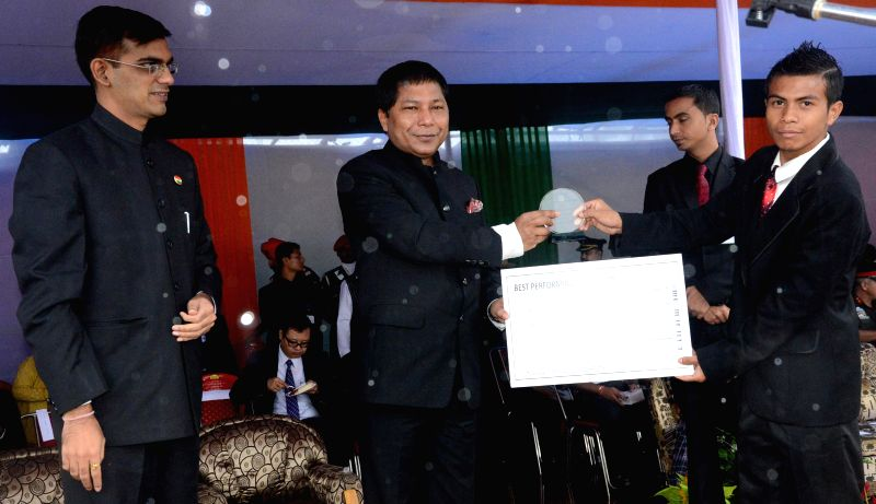 Meghalaya Chief Minister Dr Mukul Sangma hands over the trophy and certificate for best performing CSC to Damangshwa Wahlang during the Independence Day celebrations in Shillong on Aug 15, 2014.