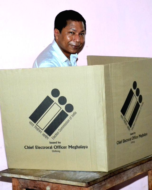 Meghalaya Chief Minister Mukul Sangma with his wife Dikkanchi D Shira and daughter after casting votes during the by-poll to Tura Lok Sabha seat in Meghalaya, on May 16, 2016. - Mukul Sangma