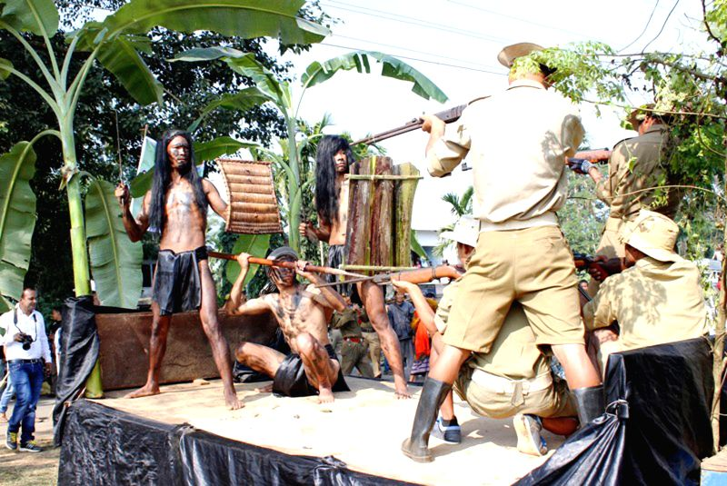 Garos take part in a carnival organised to mark the inauguration of the two-day long `Simsang Festival 2014` held at Williamnagar (East Garo Hills), Meghalaya on Dec 3, 2014.