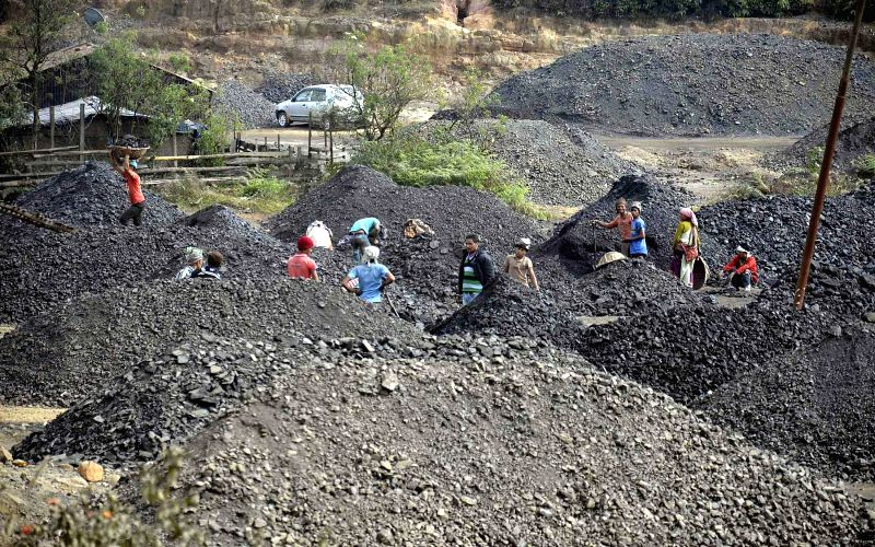 "People engage in ""rat hole"" mining defying the National Green Tribunal ban on the primitive surface mining method that entails clearing ground vegetation and digging pits ranging"