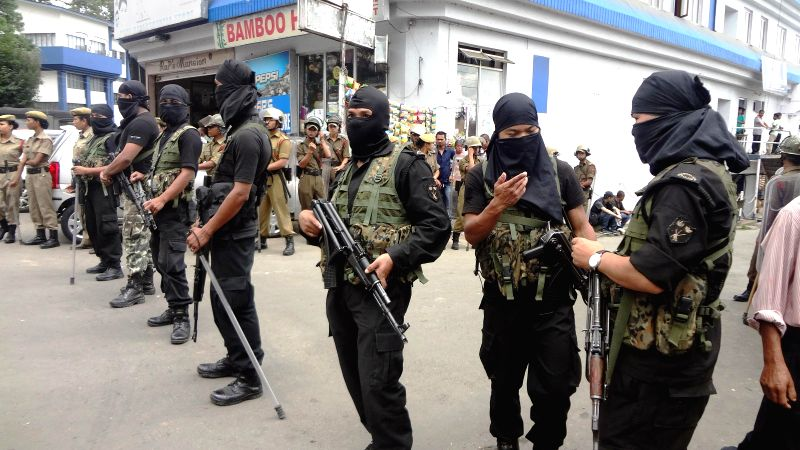 Meghalaya Police's SWAT team stand on guard at the approach to the High Court during the National Green Tribunal hearing in Shillong  on August 1, 2014.