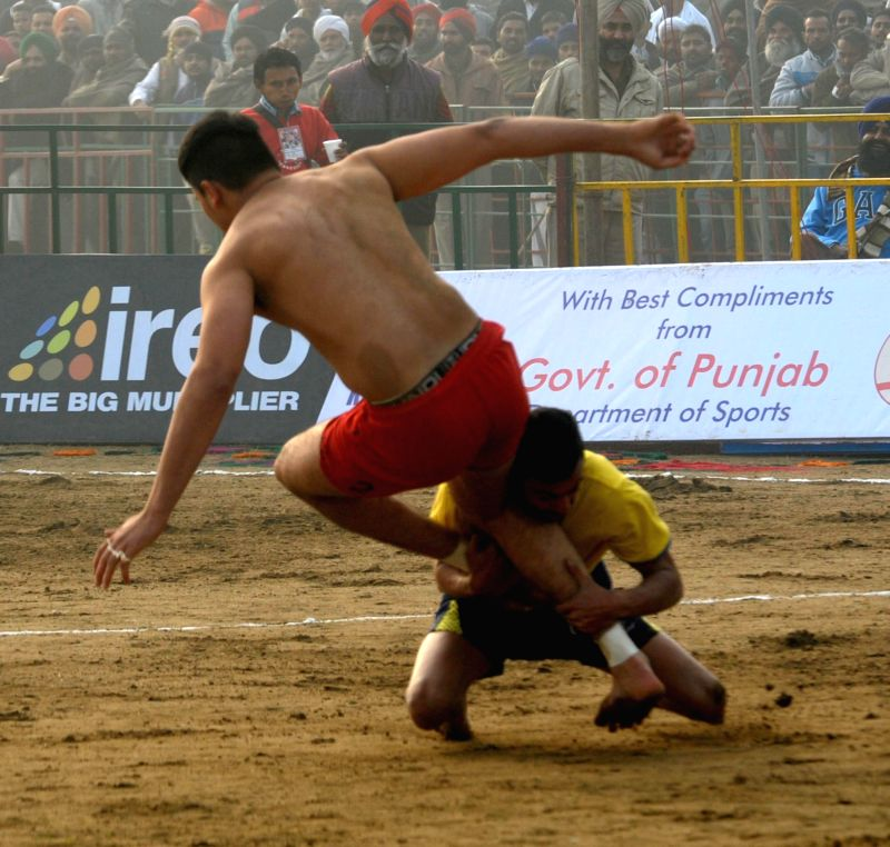 Mehta Chownk: Players in action during the 5th World Cup Kabaddi match between Canada and Sweden at Mehta Chownk, 40 km away from Amritsar on Dec. 17, 2014. Canada won.