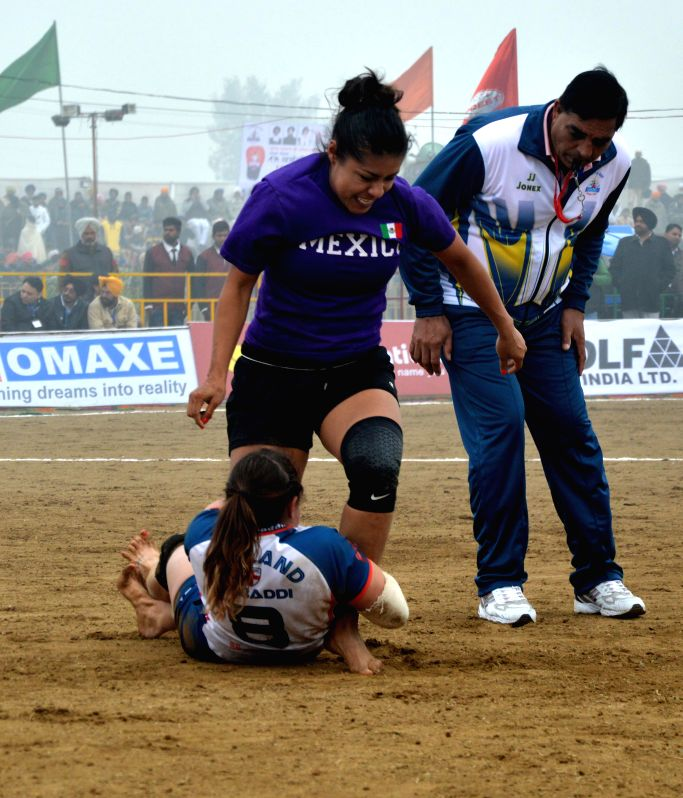 Mehta Chownk: Players in action during the 5th World Cup Kabaddi match between England and Mexico at Mehta Chownk, 40 km away from Amritsar on Dec. 17, 2014. England won.