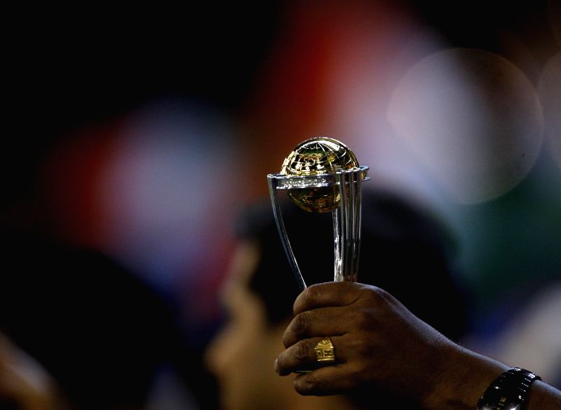 A fan holds a replica of the World Cup during an ICC World Cup 2015 match between India and South Africa at Melbourne Cricket Ground, Australia on Feb 22, 2015.