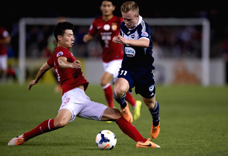 Mei Fang (L) of Guangzhou Evergrande competes during the AFC Champions League against Melbourne Victory at Etihad Stadium in Melbourne, Australia, April 15, ...