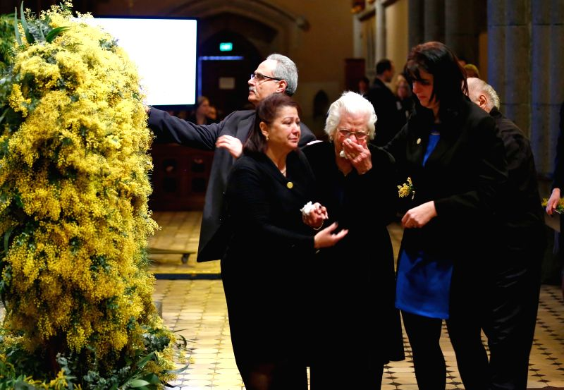 Mourners attend a national memorial service as Australians mourn the loss of all victims of Malaysia Airlines Flight MH17 at St. Patrick's Cathedral in Melbourne, .