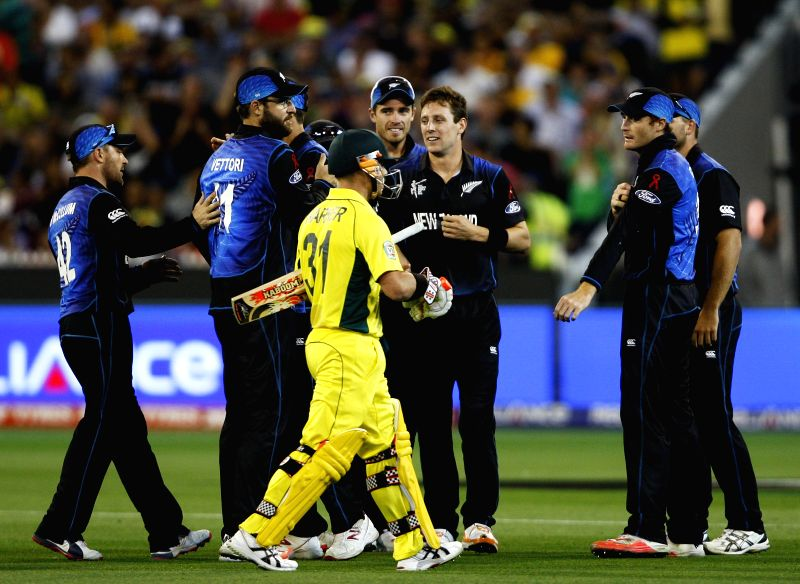 Melbourne (Australia): Australia cricketer David Warner walks off the field after being dismissed during the the final match of ICC World Cup 2015 between Australia and New Zealand at Melbourne ...
