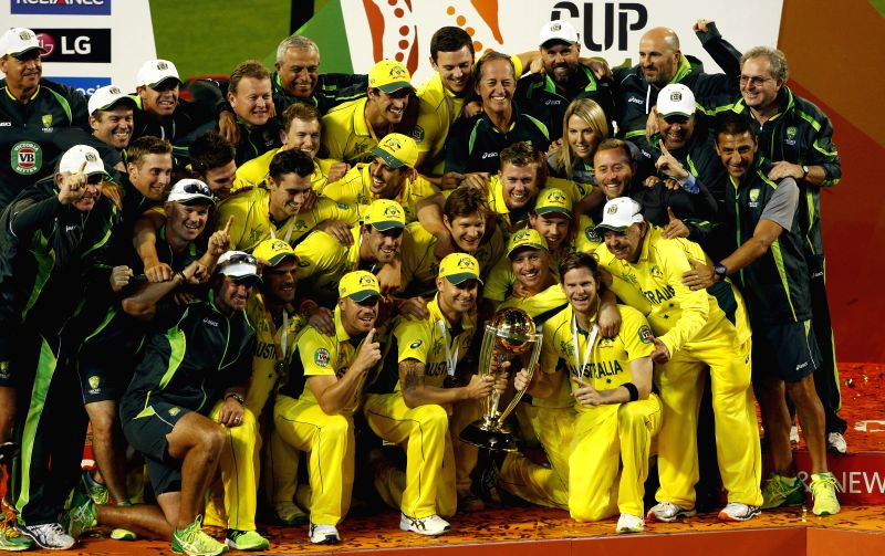 Melbourne (Australia): Australian cricketers celebrate after winning winning the 2015 ICC Cricket World Cup against New Zealand at Melbourne Cricket Ground in Australia on March 29, 2015.