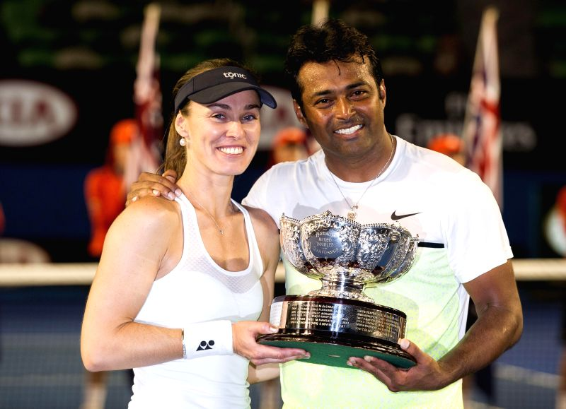 Martina Hingis (L) of Switzerland and Leander Paes of India show their trophies after winning mixed doubles final match against Kristina Mladenovic of France and .. - Martina Hingis
