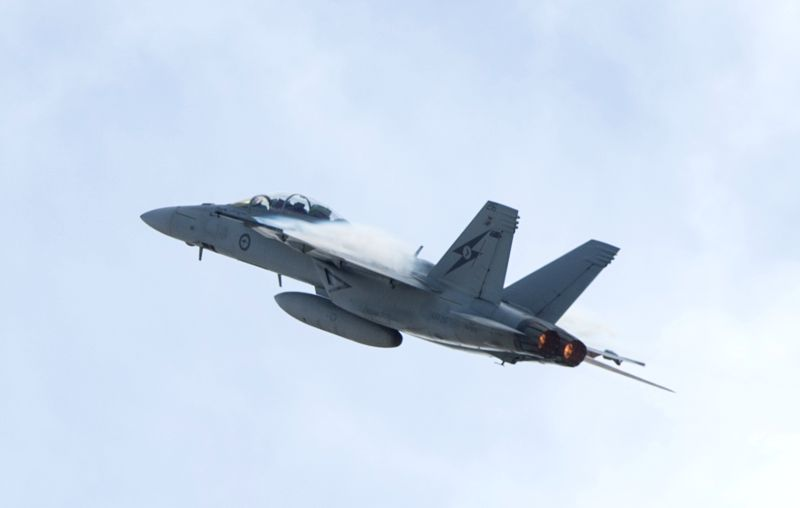 A Royal Australian Air Force F-18 Hornet performs at the Australian International Airshow on the Industry Expo day at the Avalon Airfield, southwest of Melbourne, ...