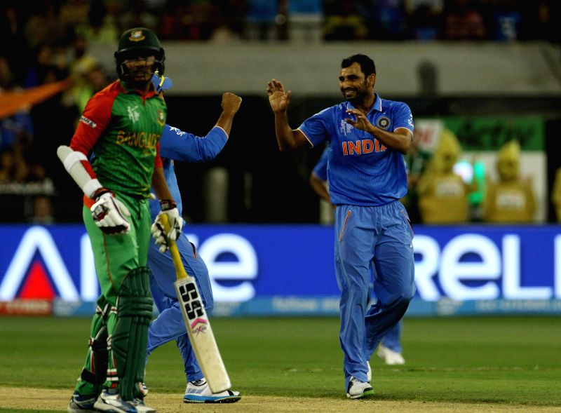 Indian bowler Mohammed Shami celebrates fall of a wicket during the ICC World Cup - 2015 quarter final match between India and Bangladesh at Melbourne Cricket Ground in Australia on March ... - Mohammed Shami