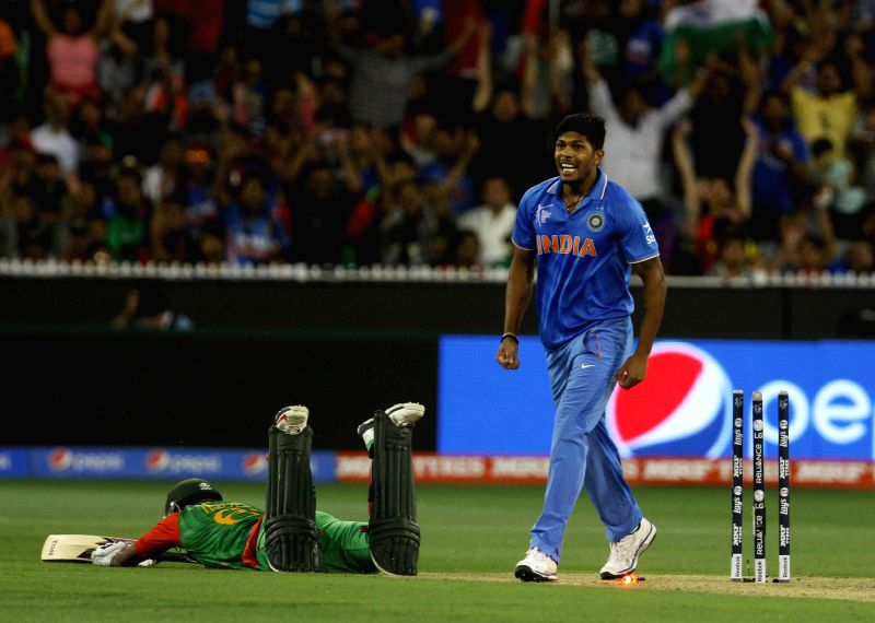 Indian bowler Umesh Yadav celebrates fall of a wicket during the ICC World Cup - 2015 quarter final match between India and Bangladesh at Melbourne Cricket Ground in Australia on March 19, ... - Umesh Yadav