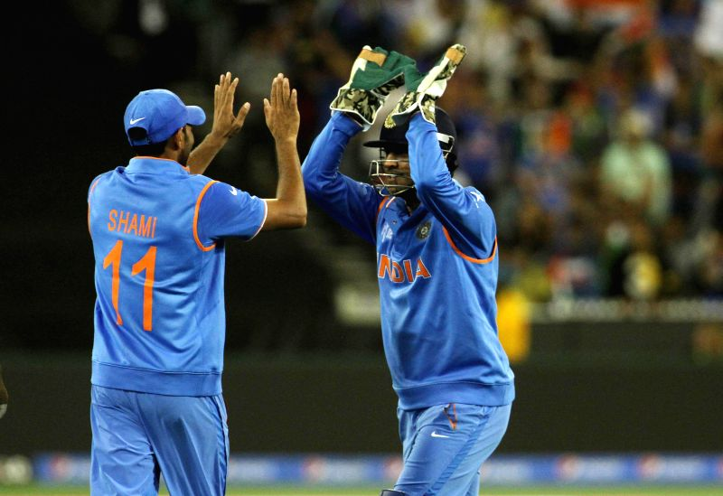 Indian captain M S Dhoni with Mohammed Shami celebrates fall of a wicket during the ICC World Cup - 2015 quarter final match between India and Bangladesh at Melbourne Cricket Ground in ... - M S Dhoni