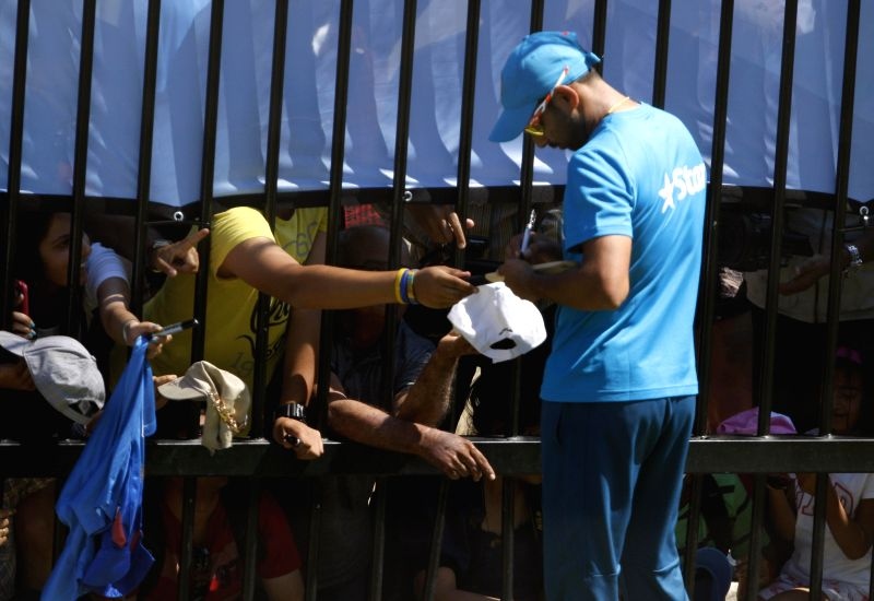 Indian cricketer Mohammed Shami signs autographs during a practice session at Melbourne Cricket Ground (MCG) ahead of an ICC World Cup 2015 match - scheduled to be held on 22nd Feb 2015 - ...