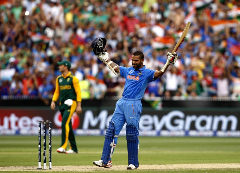 Indian cricketer Shikhar Dhawan celebrates his century during an ICC World Cup 2015 match between India and South Africa at Melbourne Cricket Ground, Australia on Feb 22, 2015. - Shikhar Dhawan