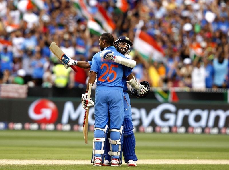 Indian cricketers Shikhar Dhawan and Ajinkya Rahane during an ICC World Cup 2015 match between India and South Africa at Melbourne Cricket Ground, Australia on Feb 22, 2015. - Shikhar Dhawan